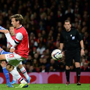LONDON, ENGLAND - OCTOBER 29: Juan Mata of Chelsea shoots to score his side's second goal during the Capital One Cup Fourth Round match between Arsenal and Chelsea at the Emirates Stadium on October 29, 2013 in London, England. (Photo by Jamie McDonald/Getty Images)