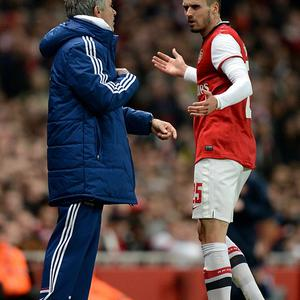 Chelsea manager Jose Mourinho (left) speaks with Arsenal's Carl Jenkinson during the Capital One Cup, Fourth Round match at the Emirates Stadium, London.