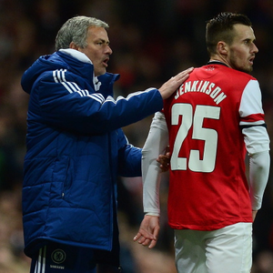 Chelsea manager Jose Mourinho pats Carl Jenkinson of Arsenal on the back during the Capital One Cup Fourth Round match between Arsenal and Chelsea at the Emirates Stadium on October 29, 2013 in London, England. (Photo by Jamie McDonald/Getty Images)