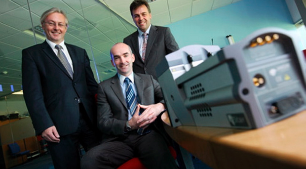 Conor Walsh, chief executive of Andor Technology, pictured in the centre with, left, Colin Walsh, the chairman of Andor, and Alastair Hamilton, the chief executive of Invest NI