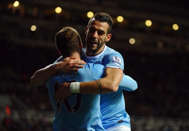 NEWCASTLE UPON TYNE, ENGLAND - OCTOBER 30: Ålvaro Negredo of Manchester City celebrates scoring their first goal in extra time with Edin Dzeko of Manchester City during the Capital One Cup Fourth Round match between Newcastle United and Manchester City at St James' Park on October 30, 2013 in Newcastle upon Tyne, England. (Photo by Laurence Griffiths/Getty Images)