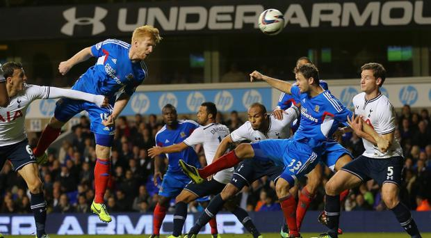 LONDON, ENGLAND - OCTOBER 30: Paul McShane of Hull heads in his side's second goal during the Capital One Cup Fourth Round match between Tottenham Hotspur and Hull City at White Hart Lane on October 30, 2013 in London, England. (Photo by Clive Rose/Getty Images)