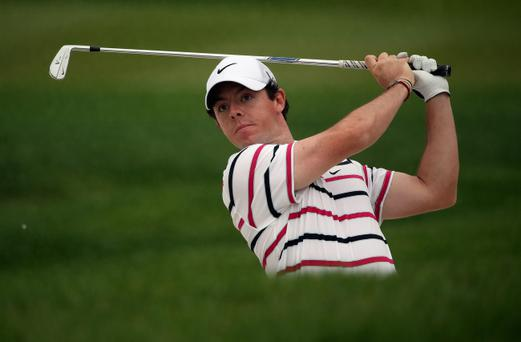 SHANGHAI, CHINA - OCTOBER 31: Rory McIlroy of Northern Ireland hits his second shot on the ninth hole during the first round of the WGC - HSBC Champions at the Sheshan International Golf Club on October 31, 2013 in Shanghai, China. (Photo by Andrew Redington/Getty Images)