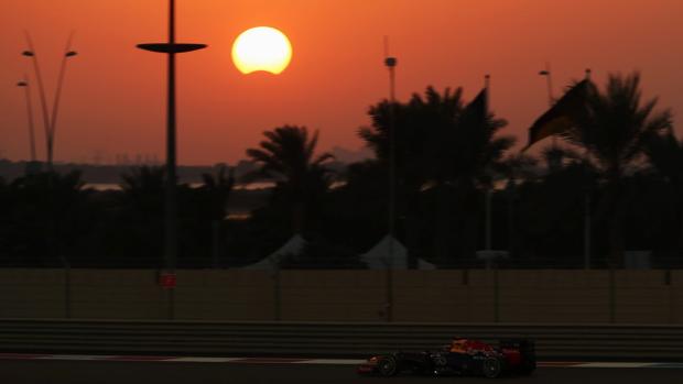 Sebastian Vettel of Germany and Infiniti Red Bull Racing drives as a rare hybrid solar eclipse takes place during the Abu Dhabi Formula One Grand Prix at the Yas Marina Circuit on November 3, 2013