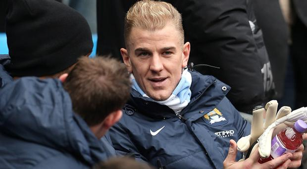 Manchester City goalkeeper Joe Hart (right) talks to team-mates James Milner and Joleon Lescott on the substitutes bench during the Barclays Premier League match at the Etihad Stadium, Manchester, Saturday November 2, 2013