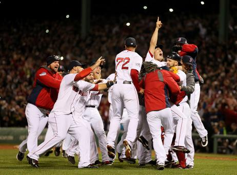 BOSTON, MA - OCTOBER 30: The Boston Red Sox celebrate after defeating the St. Louis Cardinals in Game Six of the 2013 World Series at Fenway Park on October 30, 2013 in Boston, Massachusetts. The Boston Red Sox defeated the St. Louis Cardinals 6-1. (Photo by Rob Carr/Getty Images)