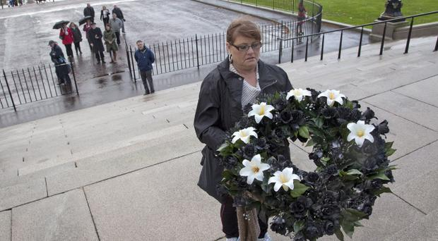 Families of the Disappeared gathered for their annual All Souls Day Silent Walk in Stormont Estate in Belfast on Saturday. A black wreath which encompasses white lilies to symbolise those still missing was carried by a family member to the steps of Parliament Buildings.