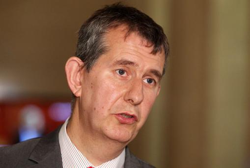 Edwin Poots has accused Sinn Fein's Gerry Adams of not reporting his paedophile brother Liam to authorities