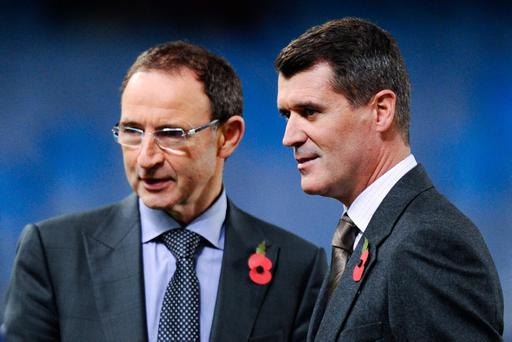 Martin O'Neill (L) and Roy Keane look on prior to the UEFA Champions League match between Real Sociedad and Manchester United