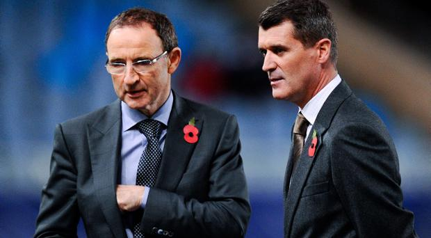 New Ireland Manager Martin O'Neill (L) and his assistant Roy Keane look on prior to the UEFA Champions League match between Real Sociedad and Manchester United (Photo by David Ramos/Getty Images)