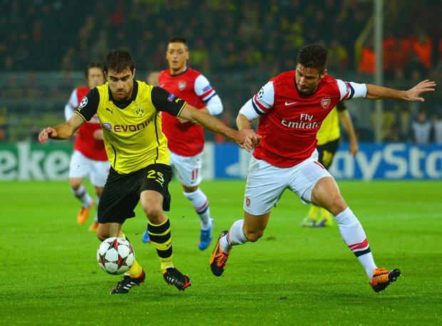 Sokratis Papastathopoulos of Borussia Dortmund and Olivier Giroud of Arsenal battle for the ball during the UEFA Champions League Group F match between Borussia Dortmund and Arsenal