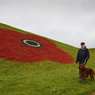 A giant poppy painted on the side of the Bathgate Pyramids in Glasgow for Remembrance Day