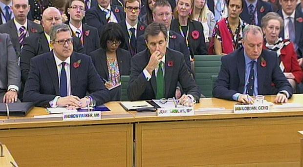 (Left to right) The Director-General of security service MI5, Andrew Parker, the Chief of the Secret Intelligence Service, Sir John Sawers and Director of GCHQ Sir Iain Lobban talking at the first parliamentary Intelligence and Security Committee (ISC) in London