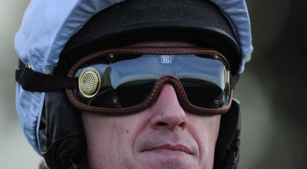 Tony McCoy riding Mountain Tunes before winning the Weatherbys Novices' Hurdle Race for his 4000th winner in Towcester