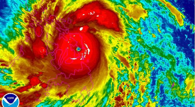 A satellite image shows Typhoon Haiyan over the Philippines, at 22:30 UTC (5:30 p.m. EST). Haiyan, the world's strongest typhoon of the year, slammed into the Philippines early Friday. (AP Photo/NOAA)