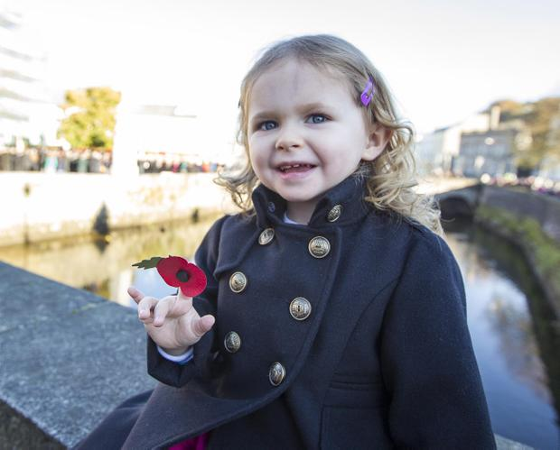 Royal British Legion Newry Branch Remembrance Sunday Service. Three Year Old Emma Andrews from the Commons, Newry. Services are taking place across the UK to remember those killed in the two world wars and other conflicts. NewRayPics