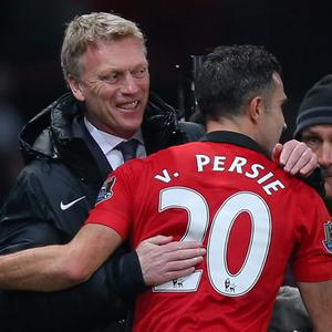 Manchester United manager David Moyes embraces Robin van Persie after the final whistle during the Barclays Premier League match at Old Trafford, Manchester.