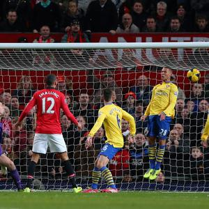 MANCHESTER, ENGLAND - NOVEMBER 10: Robin van Persie of Manchester United (not pictured) scores the opening goal past Wojciech Szczesny of Arsenal during the Barclays Premier League match between Manchester United and Arsenal at Old Trafford on November 10, 2013 in Manchester, England. (Photo by Alex Livesey/Getty Images)