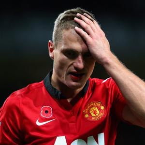 MANCHESTER, ENGLAND - NOVEMBER 10: Nemanja Vidic of Manchester United leaves the pitch after sustaining an injury during the Barclays Premier League match between Manchester United and Arsenal at Old Trafford on November 10, 2013 in Manchester, England. (Photo by Alex Livesey/Getty Images)