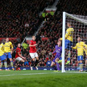 Manchester United's Robin van Persie (centre left) scores their first goal of the game with a header during the Barclays Premier League match at Old Trafford, Manchester.