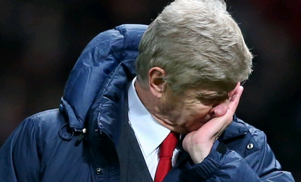 Arsenal Manager Arsene Wenger shows his dejection at the end of the Barclays Premier League match between Manchester United and Arsenal at Old Trafford on November 10, 2013 in Manchester, England