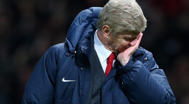 MANCHESTER, ENGLAND - NOVEMBER 10: Arsenal Manager Arsene Wenger shows his dejection at the end of the Barclays Premier League match between Manchester United and Arsenal at Old Trafford on November 10, 2013 in Manchester, England. (Photo by Alex Livesey/Getty Images)