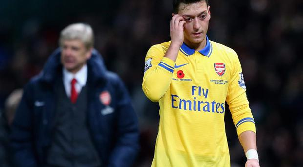 MANCHESTER, ENGLAND - NOVEMBER 10: Mesut Ozil of Arsenal walks off at the end of the Barclays Premier League match between Manchester United and Arsenal at Old Trafford on November 10, 2013 in Manchester, England. (Photo by Alex Livesey/Getty Images)