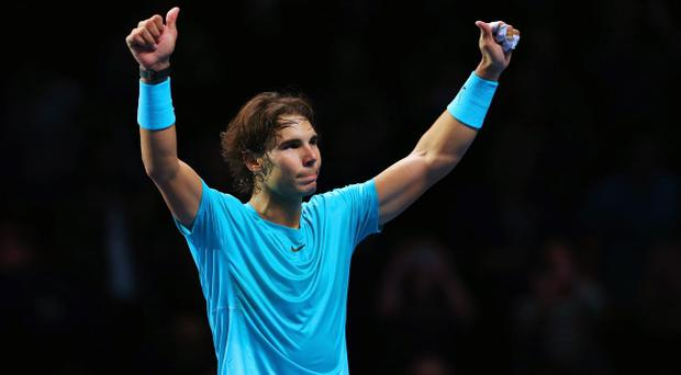 LONDON, ENGLAND - NOVEMBER 10: Rafael Nadal of Spain celebrates victory after his men's singles semi-final match against Roger Federer of Switzerland during day seven of the Barclays ATP World Tour Finals at O2 Arena on November 10, 2013 in London, England. (Photo by Julian Finney/Getty Images)