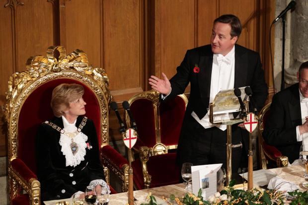 Prime Minister David Cameron with Lady Judge Lord Mayor Alderman Fiona Woolf during speeches at the Lord Mayor's Banquet, at the Guildhall in the City of London.