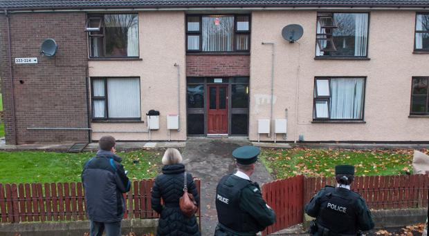 Police at the scene outside a block of flats in the Carnhill area of Derry where a fire in a communal stairway was discovered early on Friday morning. Pic Martin McKeown