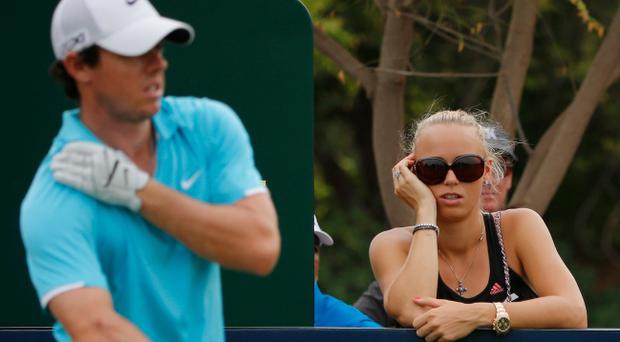 Caroline Wozniacki watches Rory McIlroy during the during the final round of the 2013 DP World Championships in Dubai