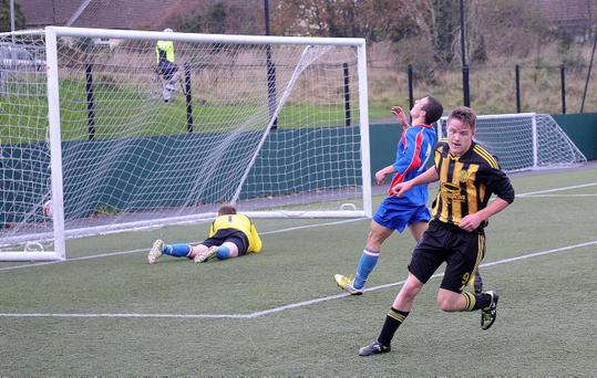 Action from Tullycarnet v Temple Rangers, November 16