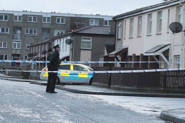 Police at the scene in Coleraine where a 15-year-old boy was shot by a gang of masked men in a house in Coleraine. Photo Mark Jamieson.