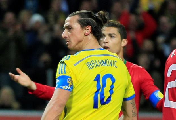 Portugal's Cristiano Ronaldo, back, reacts after Sweden's Zlatan Ibrahimovic scored his side's first goal during the World Cup qualifying playoff second leg soccer match between Sweden and Portugal in Stockholm, Sweden, Tuesday, Nov.19, 2013. (AP Photo/Frank Augstein)