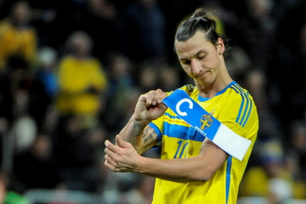 Sweden's forward Zlatan Ibrahimovic removes the captain's armband, after the World Cup 2014 qualifying playoff second leg soccer match between Sweden and Portugal, at Friends Arena in Stockholm, Tuesday, Nov. 19, 2013. Sweden lost 2-3. (AP/TT/Erik Martensson)