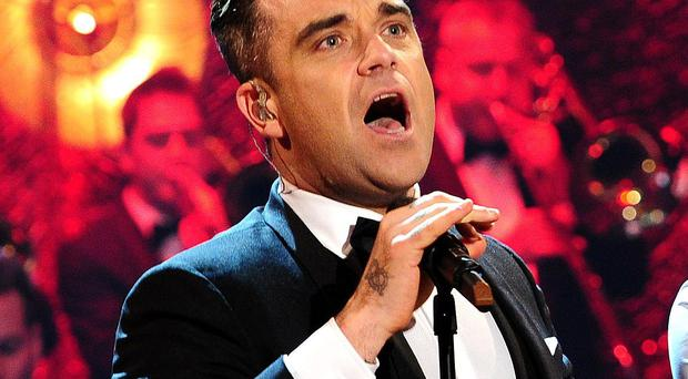 Robbie Williams and Olly Murs during filming of the Graham Norton show at the London studios.