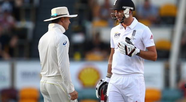 BRISBANE, AUSTRALIA - NOVEMBER 24: Michael Clarke of Australia and James Anderson of England exchange words during day four of the First Ashes Test match between Australia and England at The Gabba on November 24, 2013 in Brisbane, Australia. (Photo by Ryan Pierse/Getty Images)