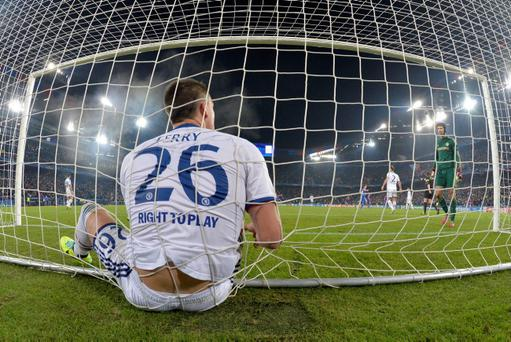 Chelsea's John Terry, left and Chelsea's goalkeeper Petr Cech react after FC Basel's Mohamed Salah scored, during their Champions League group E soccer match, at St. Jakob-Park stadium in Basel, Switzerland, Tuesday, Nov. 26, 2013. (AP Photo/Keystone, Peter Klaunzer)