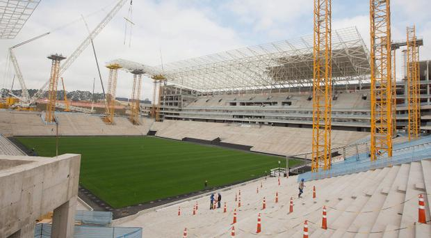 Construction in August at the Itaquerao Stadium, also known as Arena Corinthians, in Sao Paulo, Brazil. Part of the stadium that will host the World Cup opener in Brazil next year collapsed on Wednesday, causing significant damage and killing three people, authorities said. (AP Photo/Andre Penner, File)
