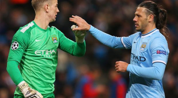 MANCHESTER, ENGLAND - NOVEMBER 27: Joe Hart of Manchester City is congratulated by Martin Demichelis after making a save during the UEFA Champions League Group D match between Manchester City and FC Viktoria Plzen at Etihad Stadium on November 27, 2013 in Manchester, England. (Photo by Alex Livesey/Getty Images)