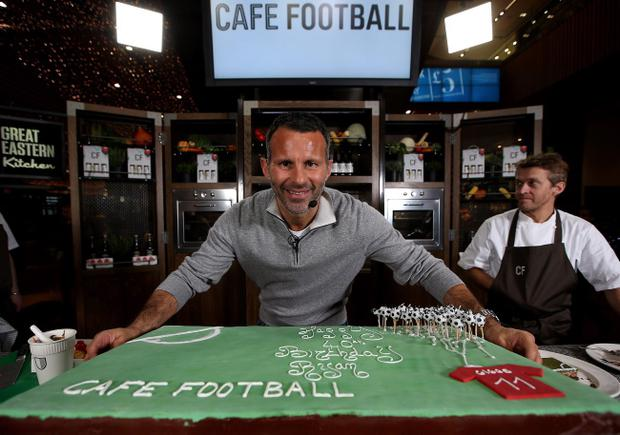 LONDON, ENGLAND - NOVEMBER 20: Ryan Giggs celebrates his 40th Birthday with a Café Football turf cake at Westfield Stratford City on November 20, 2013 in London, England. Giggs will be 40 on Friday 29th November and opens the new restaurant Café Football with former teammate Gary Neville next month. (Photo by Jan Kruger/Getty Images for Cafe Football)