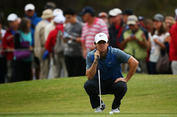 Rory McIlroy of Northern Ireland lines up a putt during day two of the Australian Open at Royal Sydney Golf Club on November 29, 2013 in Sydney, Australia. Photo by Matt King