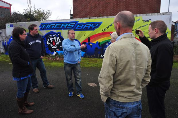 John Howcroft (centre) during a tour of the Tigers Bay area a few years ago. Photo: Pacemaker