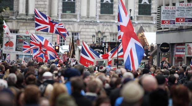 Loyalist protesters wave union flags at Belfast City Hall on November 30, 2013. The subject of flags has proved to be a major sticking point for Richard Haass