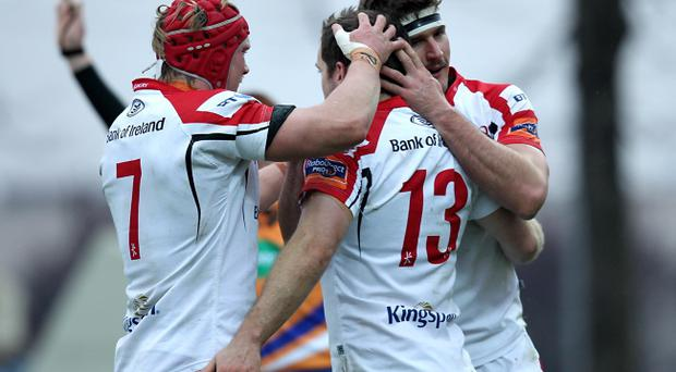 Ulster players celebrate a try against Zebre