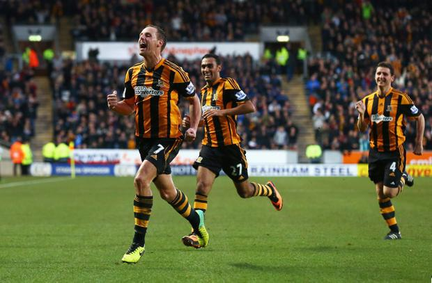 David Meyler (L) of Hull City celebrates scoring his team's second goal with team mates during the Barclays Premier League match against Liverpool