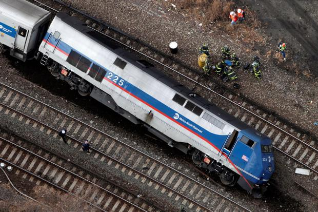 A Metro-North locomotive lies on its side after derailing, Sunday, Dec. 1, 2013 in the Bronx borough of New York