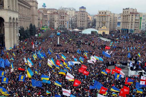 Demonstrators gather during a rally in downtown Kiev, Ukraine, on Sunday, Dec. 1, 2013