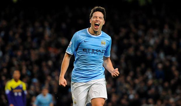 Manchester City's Samir Nasri celebrates scoring his side's 3rd goal during the Barclays Premier League match at the Etihad Stadium