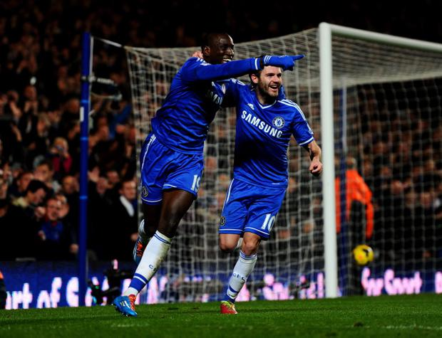 LONDON, ENGLAND - DECEMBER 01: Demba Ba of Chelsea (L) celebrates with Juan Mata (R) as he scores their third goal during the Barclays Premier League match between Chelsea and Southampton at Stamford Bridge on December 1, 2013 in London, England. (Photo by Mike Hewitt/Getty Images)